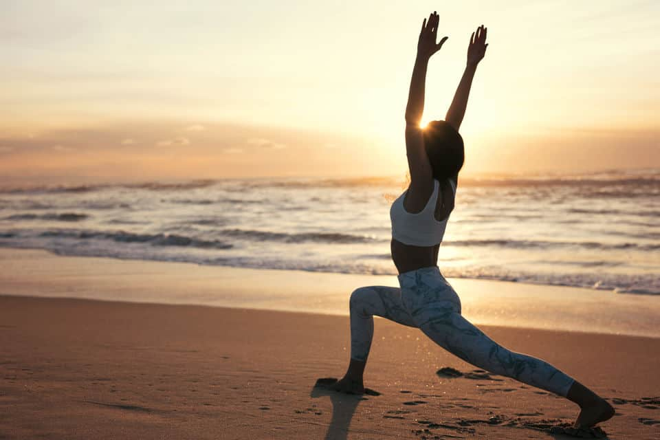 Sporty Young Woman Doing Yoga Practice At The Beach Concept Of Healthy Life And Natural Balance Between Body And Mental Development