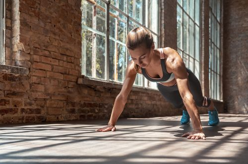 woman exercising doing planks improving body awareness for injury prevention