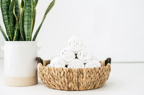 Clean towels in a basket idea of fitness gym spa