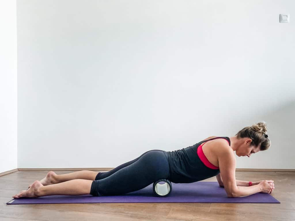 woman using a foam roller on hip flexors