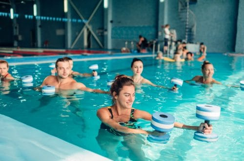 aquatic exercise class using aquatic exercise equipment