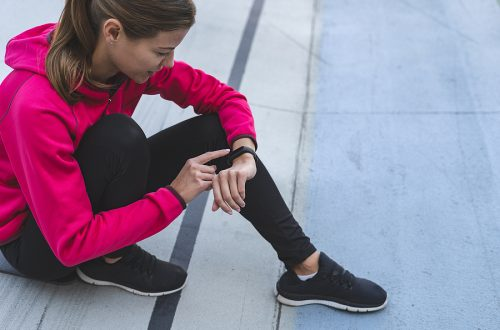 girl using a fitness tracker