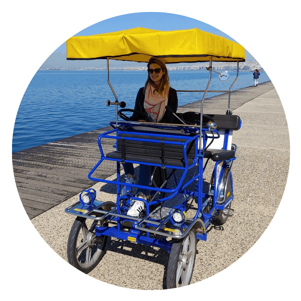 woman in a two person pedal cart