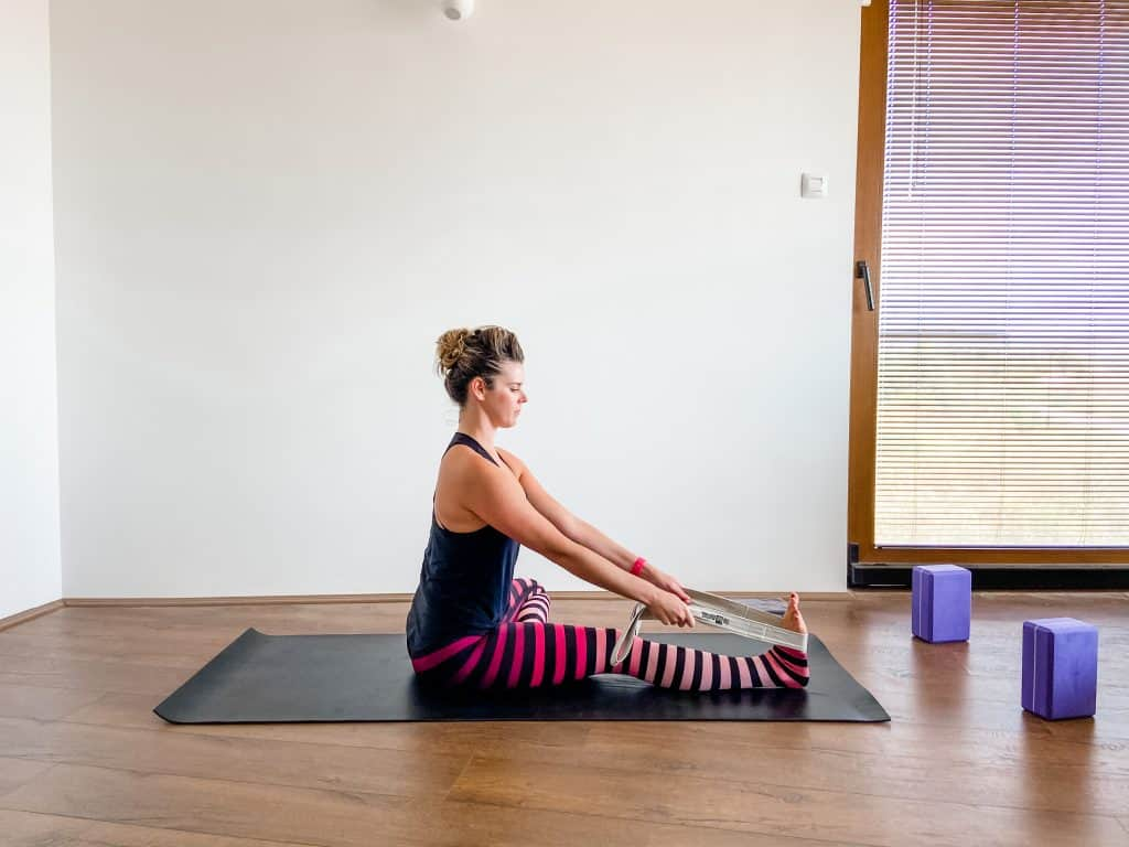 seated hamstring stretch with a strap