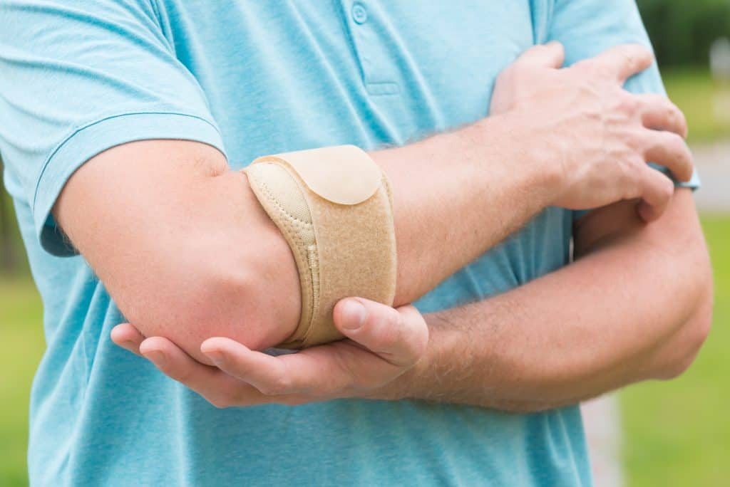 man wearing a counterforce brace on his elbow for tennis elbow