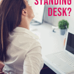 woman sitting at a desk holding her back in pain with text overlay do you need a standing desk?