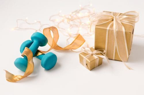 presents and blue dumbbells gifts for fitness lovers